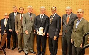 Mart Tisdal (center); Owen L. Anderson, Eugene Kuntz Chair of Law in Oil, Gas and Natural Resources at the University of Oklahoma College of Law and past recipient (fourth from left); Joseph Harroz. Jr., Dean of the University of Oklahoma College of Law (third from right); and past recipients (left to right) Philip D. Hart, Mark D. Christiansen, R. Clark Musser, Jack Horner and Henry Hood.