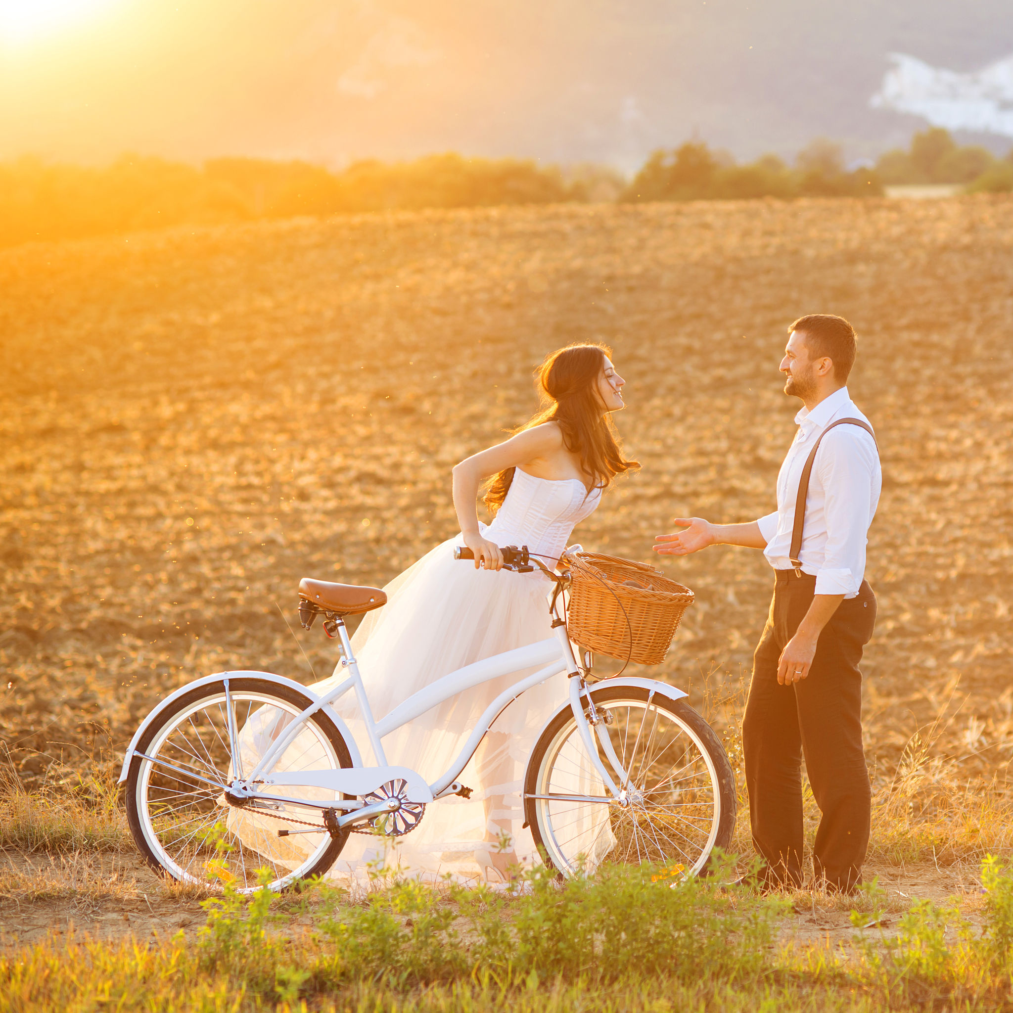 25230667 - beautiful bride and groom wedding portrait with white bike