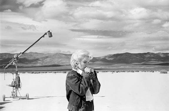 """Eve Arnold. USA. Nevada. US actress Marilyn Monroe on the Nevada desert going over her lines for a difficult scene she is about to play with Clarke Gable in the film """"The Misfits"""" by John Huston. 1960. Copyright Eve Arnold/Magnum Photos."""
