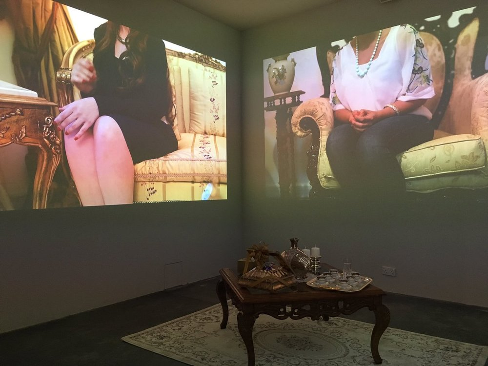 """Rania Jishi 's The Visit, is a video installation that looks at """"Salon Marriages""""and the rituals of these visits that are about finding potential brides,predominantlyin the Levant region."""