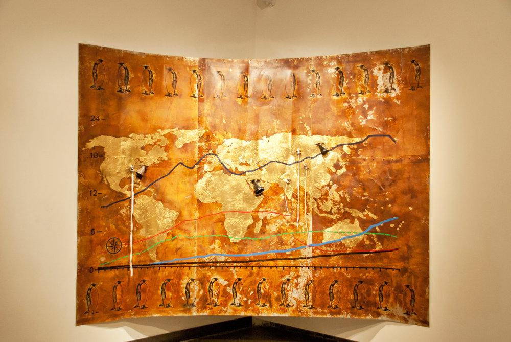 Sachin Bonde - The World 2016 Etching, serigraphy, gold leafing and enamel paint on tin sheet, and kerosene lamp burner and kerosene beakers 224 x 305 cm