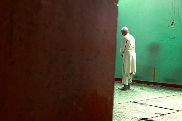 © Katarina Premfors - Prayer at Batmaloo Bus Station - Kashmir, India 2009