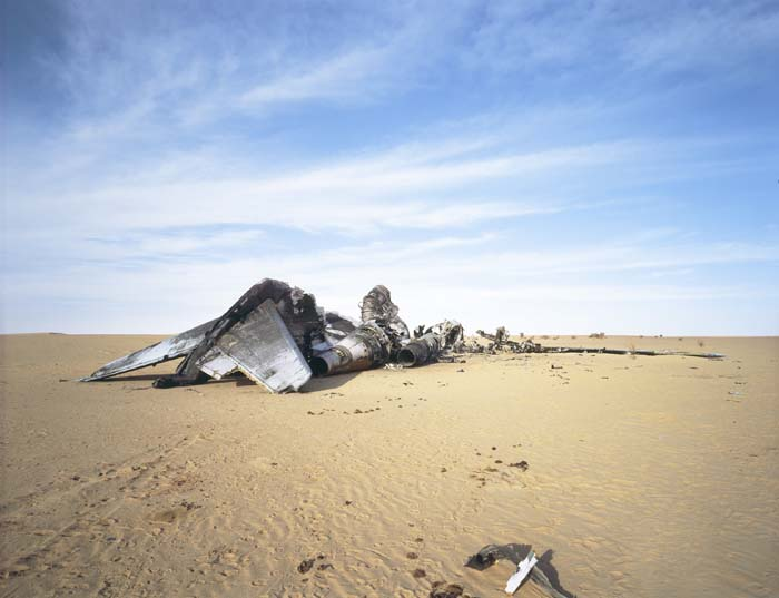 A Boeing 727 cargo plane, thought to have been carrying a large amount of cocaine torched by drug traffickersafter they had emptied it. The plane landed on an improvised airstrip in the middle of the Malian desert. In Bamako, the media called it 'Air Cocaine'. Norhern Mali, 2010 © Philippe Dudouit