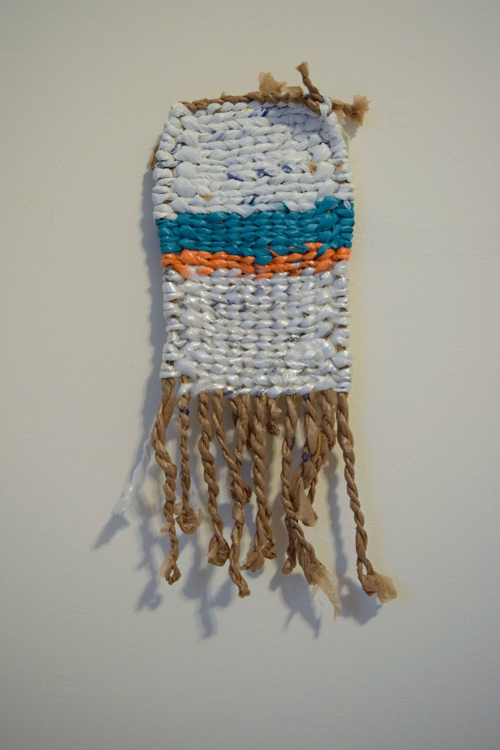 Anita Maharjan ,  Untitled , woven mat with discarded plastic.