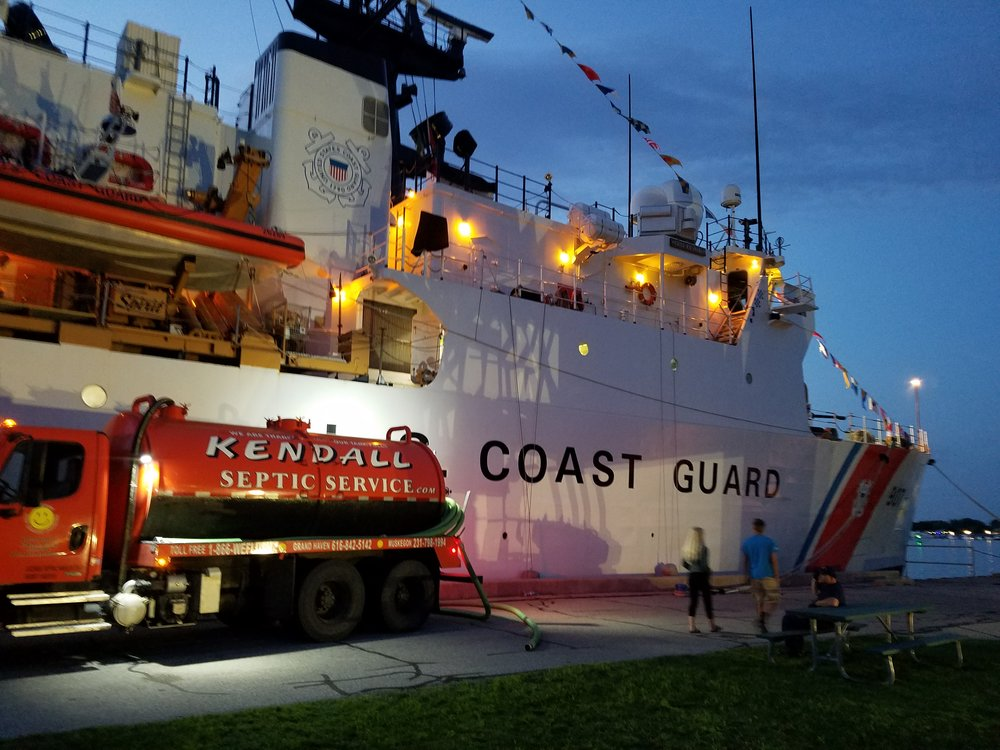 Kendall Septic Service pumping out the United States Coast Guard ship