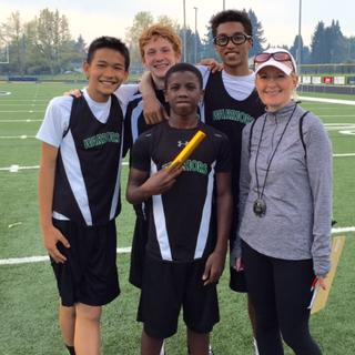 Athletic Director, Tami Kemp, with WCS track athletes.