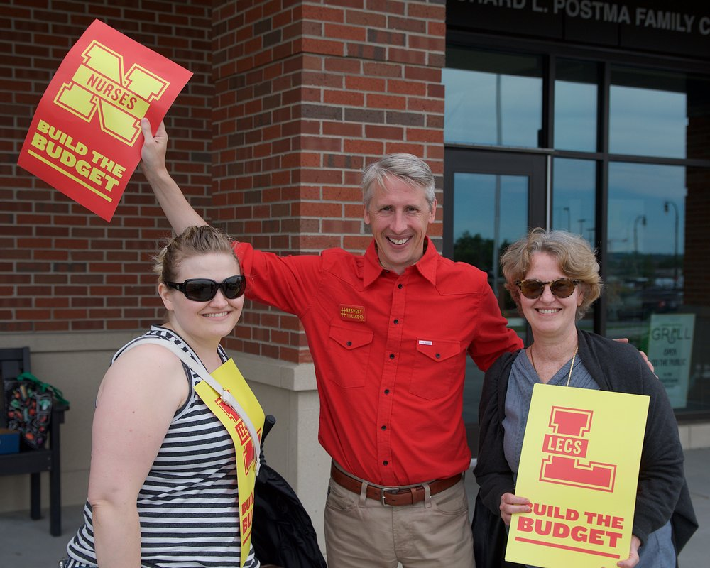 Lecturers Anita (Flint), Paul (Ann Arbor), and Debbie (Ann Arbor) at a University Board of Regents' Meeting in Summer 2018, demonstrating solidarity between UM Lecturers and UM nurses