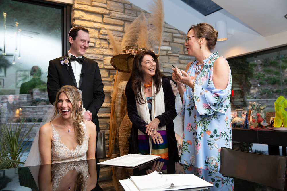 Ketubah  signing brings joy and laughter to all.