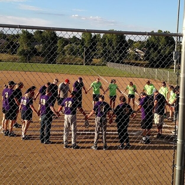 Softball Team Praying.jpg