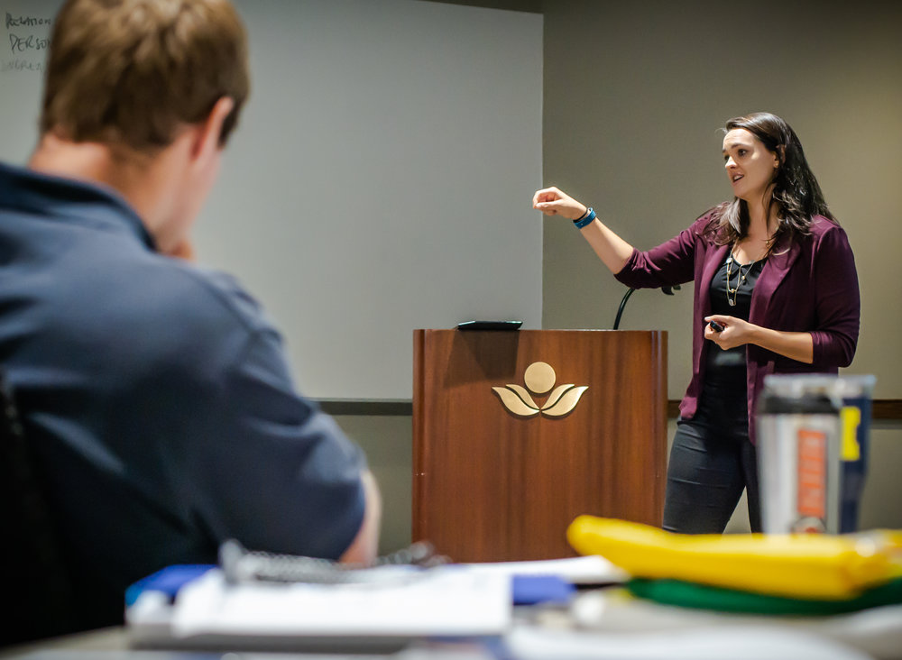 Dr. Ashley Larrimore speaks to DMEP students
