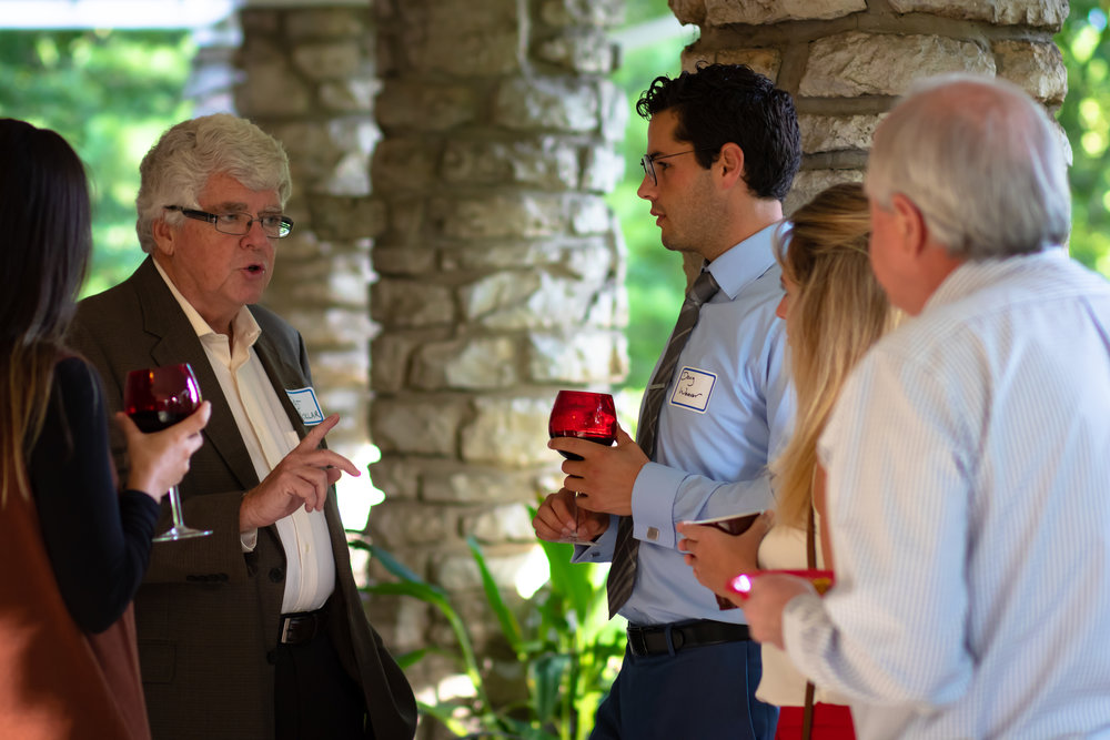 Dr. Pat Ecklar (left) speaks with a group of OSU medical students