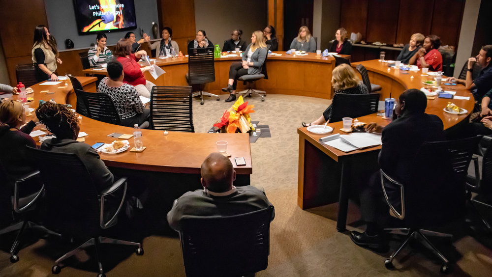 "Staff gather around the ""campfire"" for the CMA Foundation's annual Staff Campaign kickoff"