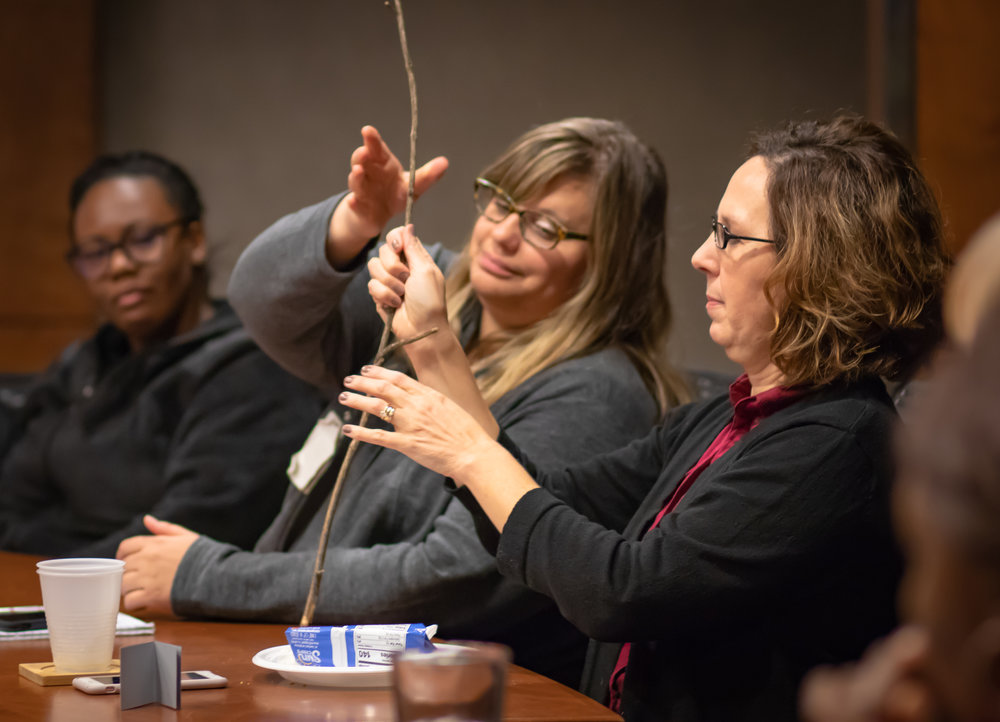 Staff members pass a marshmallow-stick during CMA Foundation's Staff Campaign kickoff
