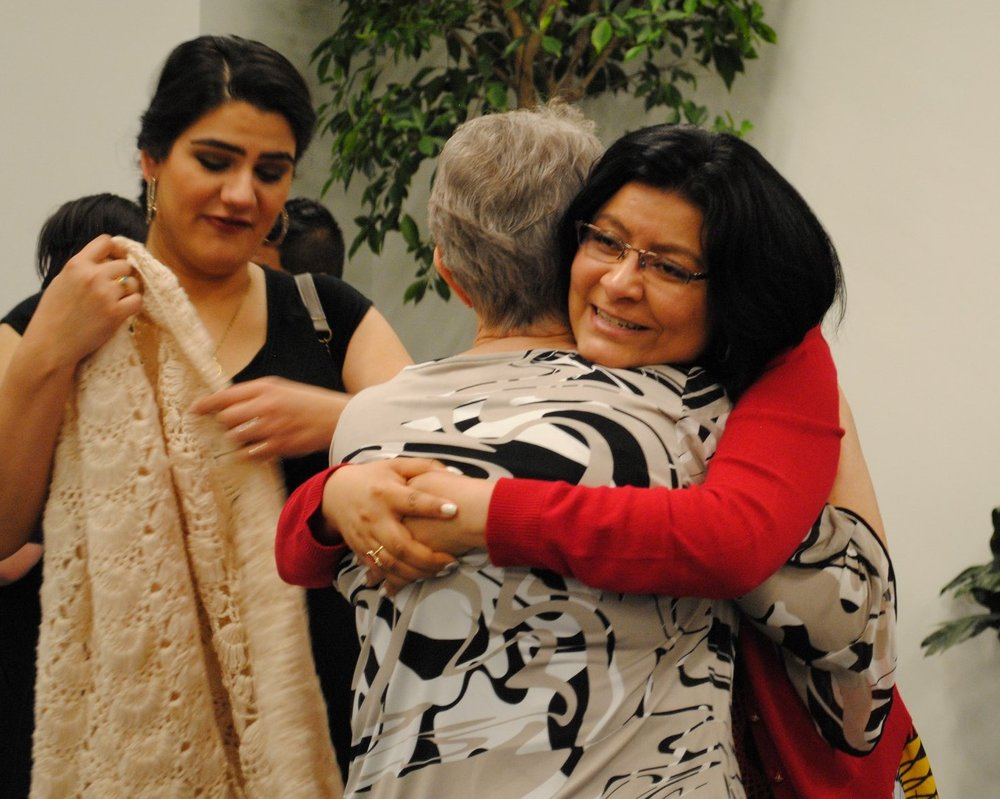 Rebeca Flores (right) hugs a coworker, photo obtained from Physicians CareConnection Facebook page.