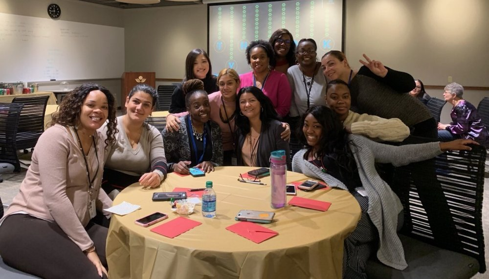 Rebeca (right of center) poses with StepOne staff, photo obtained from Physicians CareConnection Facebook page.