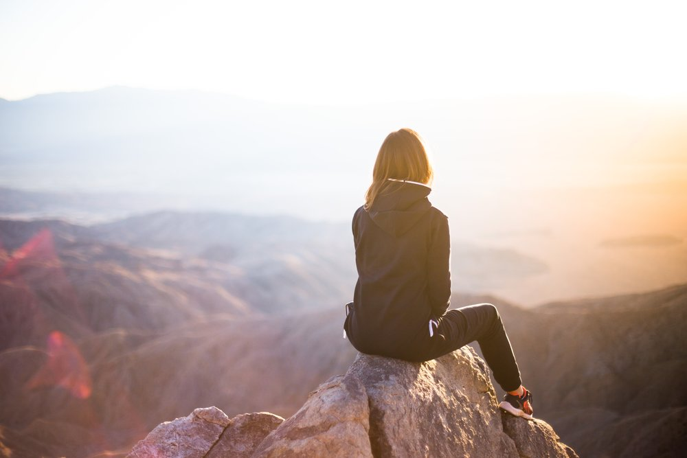 woman sitting mountaintop.JPG