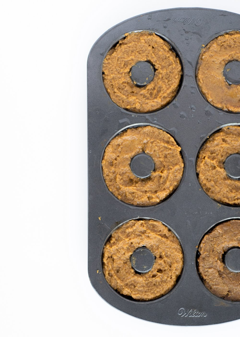 Gluten-Free Baked Pumpkin Cake Doughnuts | shutupeatthis.com