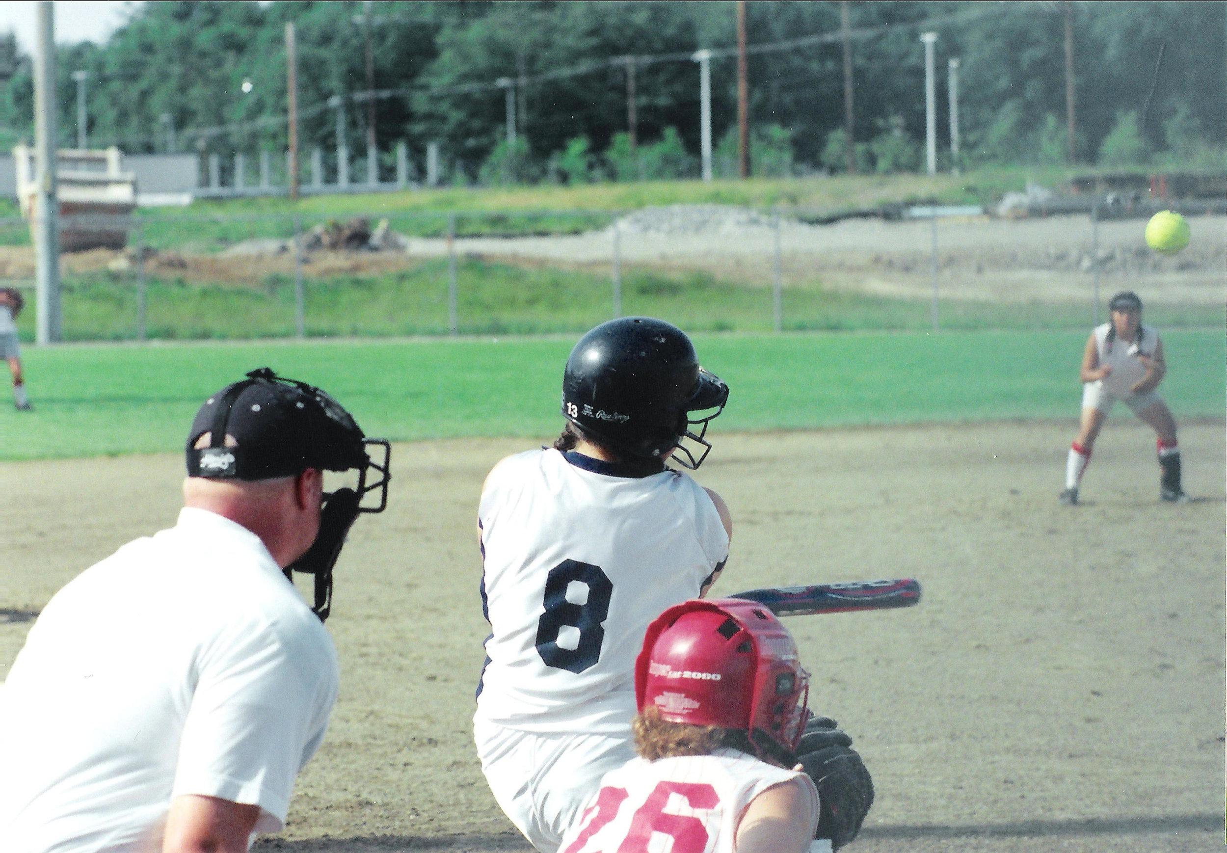 Amy (#8) playing softball.
