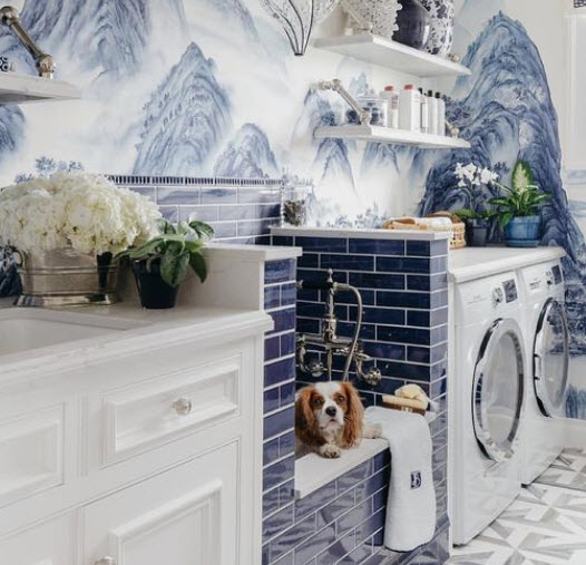 Just look at this fabulous laundry/wash room. I love the colors – not to mention that sweet little face peeking out.