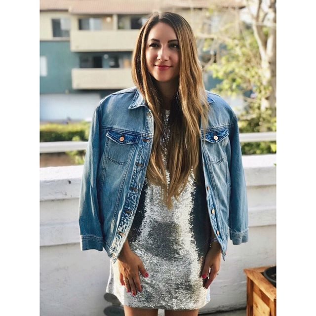 Formalwear + denim is of my favorite #fashion pairings. I love wearing my @iroparis nabara sequin dress from @saks (on sale now!) and popping on my @jcrew denim jacket for a cool and modern James Dean look.✌️ My @chanelofficial white pumps add a little polish to this dressy/casual outfit and are great for hot summer nights.✨ Penny loves them, too! 🐾💗 • • #iroparis #chanel #jcrew #irodress #sequins #sequindress #silver #tshirtdress #whitepumps #denimjacket #blue #chanelshoes #chanelheels #whiteheels #cartier #cartiertrinityring #fashionblogger #americanstyle #sandiego #california #summernights #winelover @kimcrawfordwine