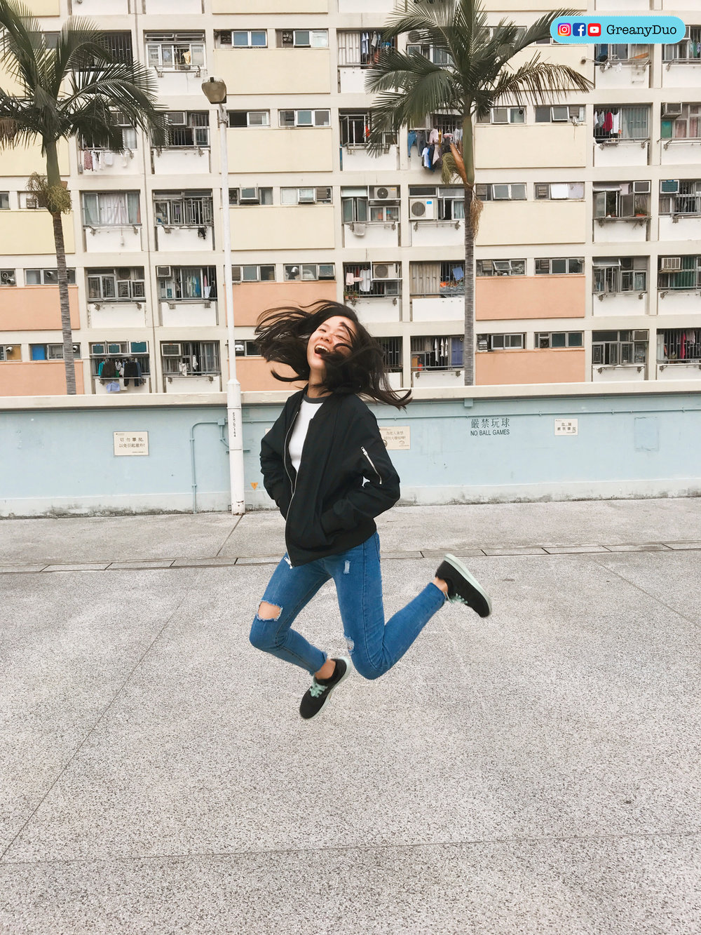 jenny jumping in front of Choi Hung Estate