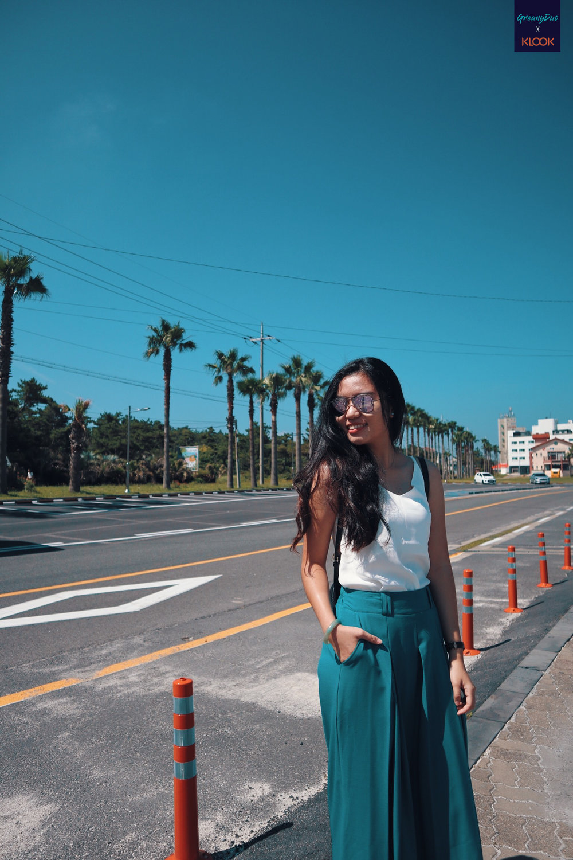 tina posting beside jeju's street