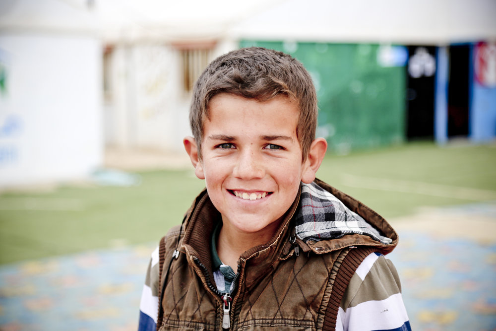 """When I first came here I used to work delivering things for people. Now I'm learning and want to build a future for myself. I want to be an agricultural engineer.""  Hassan* 13, from Syria, now lives in Za'atari camp, Jordan  80% of caregivers for Syrian refugees in Jordan, Lebanon and Iraq identified lack of access to education as their main source of stress.  © Tracy Manners/Save the Children"