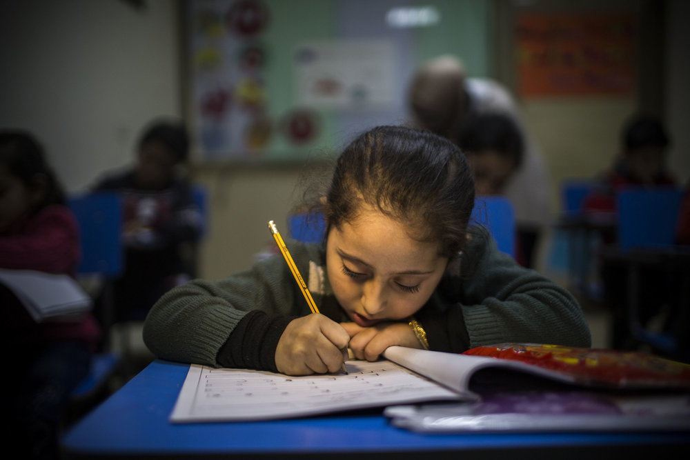 A young girl attends lessons inside Moasad Center School in Saida, Lebanon. Seven years into the crisis in Syria, Lebanon hosts 1 million registered Syrian refugees, the highest per capita number of any country.   © Terre des Hommes/Diego Ibarra Sánchez