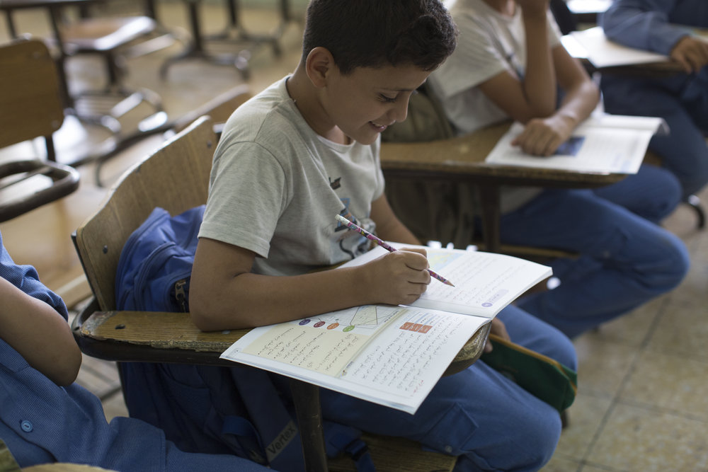 Samer**, 11, a refugee from Syria now living in Jordan, who fled his home five years ago, takes class at his school in Amman, Jordan. Jordan's inclusive education policy is critical to securing positive learning outcomes for refugee children – but its public school system is over stretched.   © Save The Children/ Ahmad Muhsen