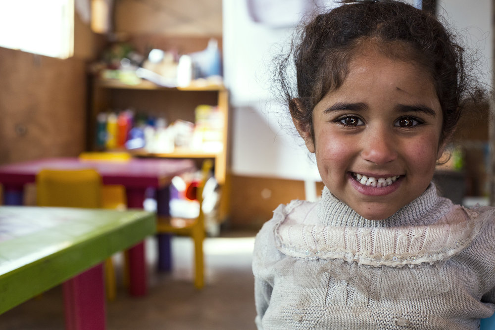 Souad* is a 5-year-old Syrian girl from Al-Raqqa. She fled Syria with her family 4 years ago when her neighbourhood was shelled. Souad* is now living with her family where she is enrolled in the early childhood development program run by Save the Children.      © Save the Children