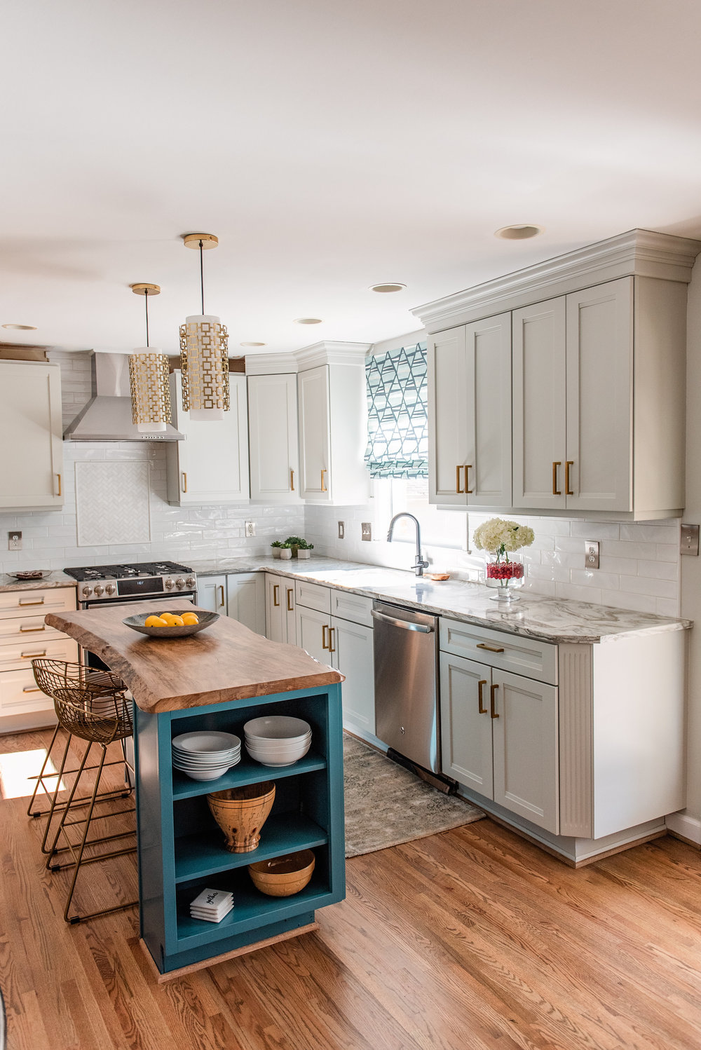 This stunning refresh of the kitchen turned out gorgeous! The white subway back splash tile is from  Crossville Tile .