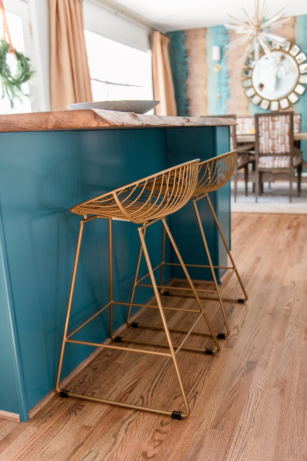 - These on trend gold counter stools by CosmoLiving by Cosmopolitan (Wayfair) complimented the blue island perfectly!