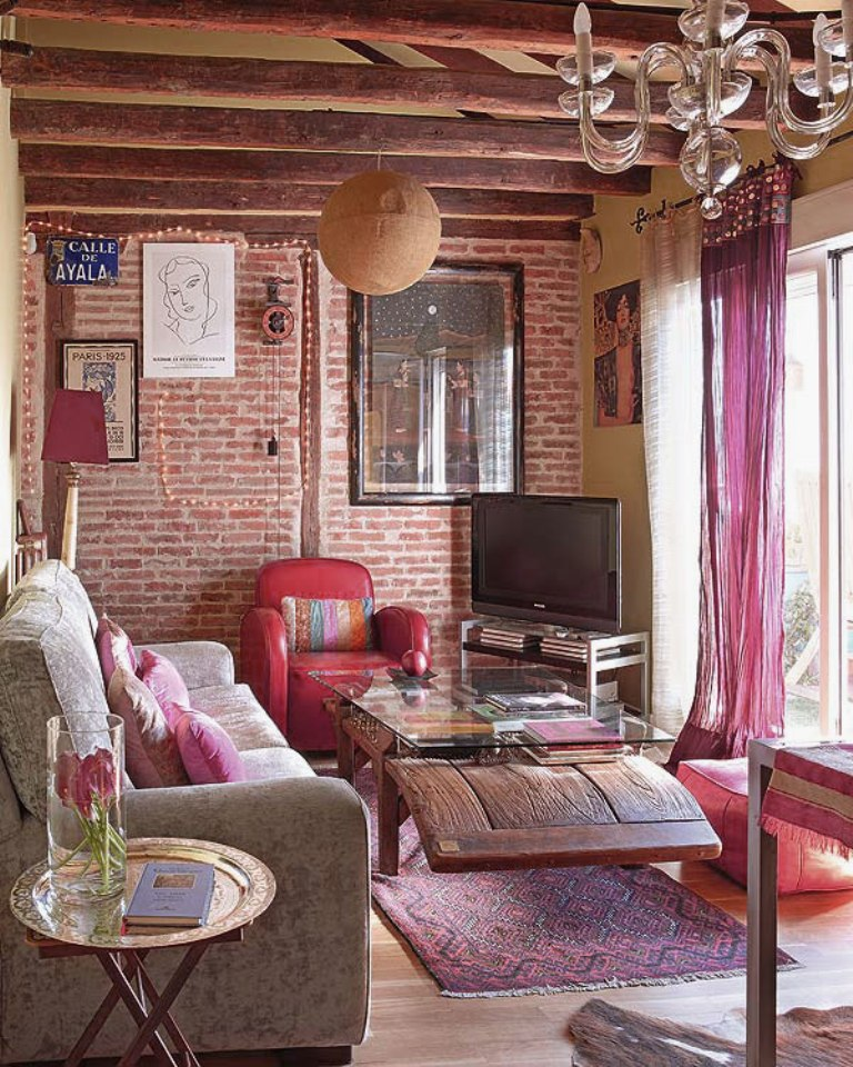 bohemian-living-room-design-with-bright-feminine-bold-color-ideas-and-exposed-brick-wall-decor-and-wooden-roof-beams-and-decorative-ethnic-pattern-accent-with-soft-textures-and-natural-furniture.jpg