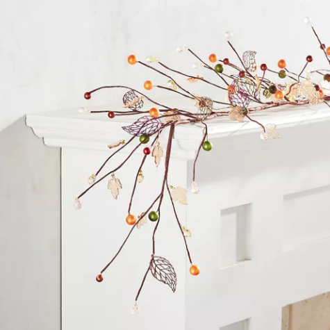 """Wild Wood Collection - Beaded Garland with Leaves - Pier 1     Gather up our handcrafted garland, adorned with autumn-colored beads and faux leaves. 1.18""""W x 1.18""""D x 60.24""""L, Iron, polyether foam, acrylic beads, paper, glitter, handcrafted. $17.48 (on sale!)"""