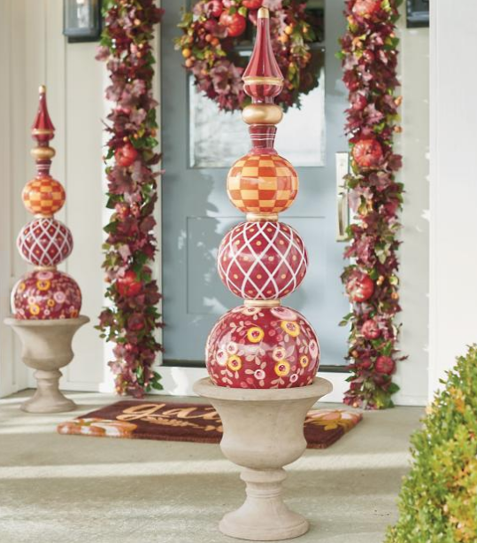 Harvest Harper Topiary   Colorful, mixed pattern topiary made of three stacked spheres topped with a finial. 4 ft. tall, for an impressive presentation, even from the street. Gold metallic accents. Lustrous, clear finish. $249