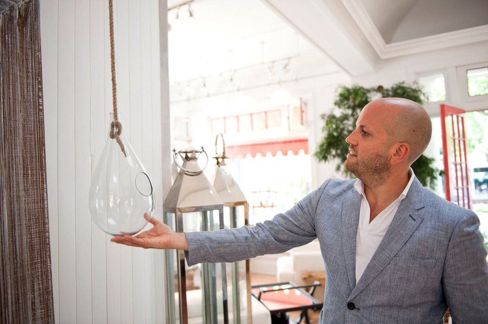 Kevin Isbell, an interior designer, and a hanging glass terrarium at homenature in Southampton, NY: $85