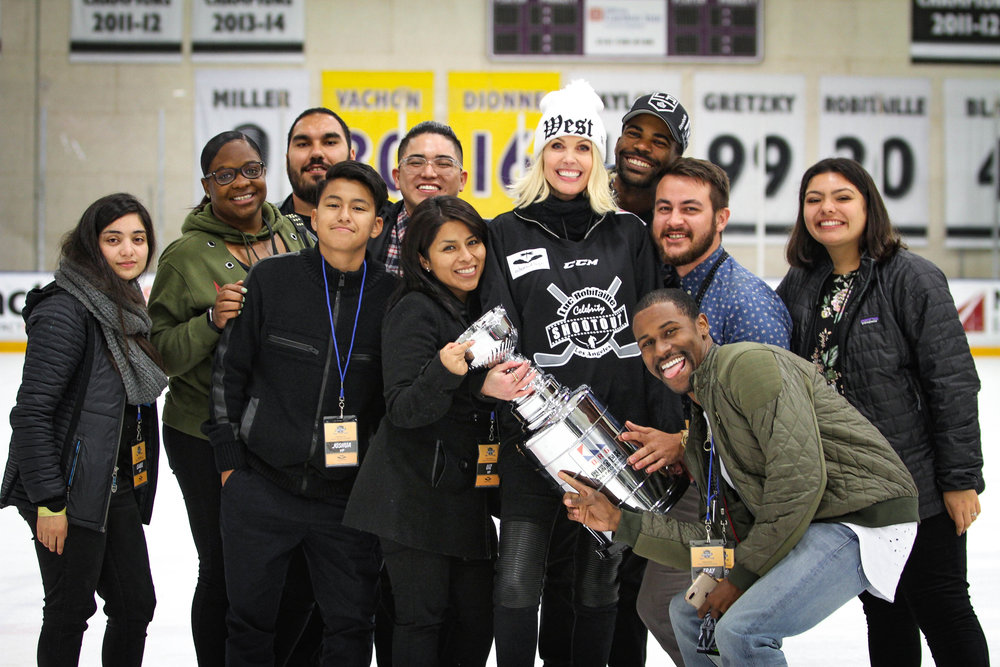 EOH Youth celebrating on ice with Stacia and Cup copy.jpg