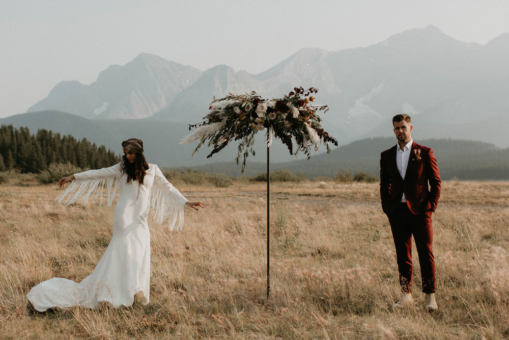 A bride and groom at their ceremony location in Banff