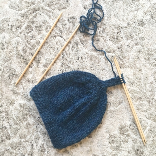 Tegan Top Knot Baby Hat — Needles   Notes 932cea06c03