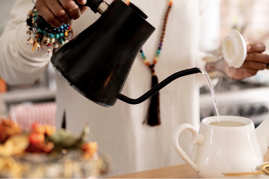Pouring Tea from Kettle