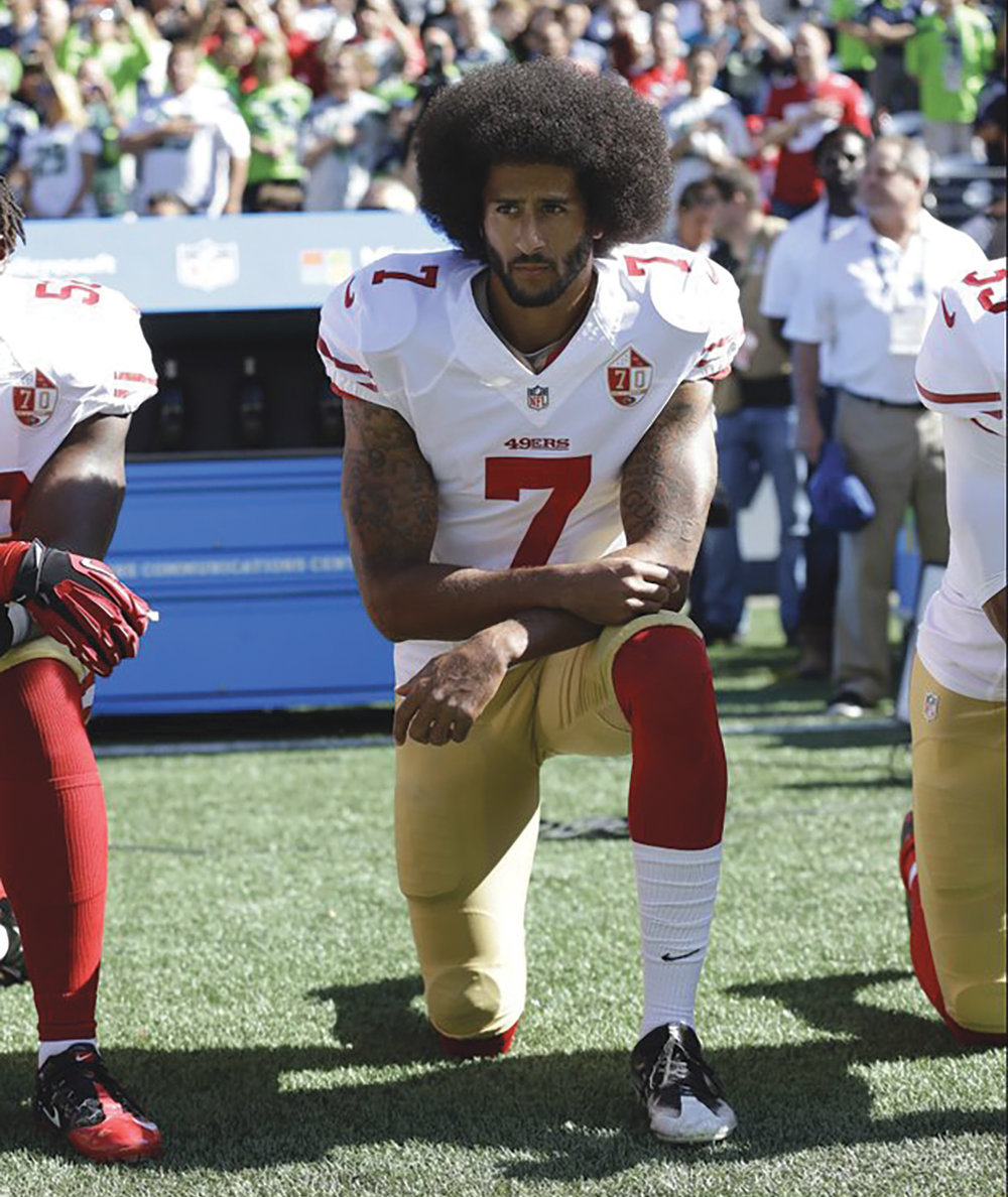 "FILE- In this Sept. 25, 2016, file photo, San Francisco 49ers' Colin Kaepernick kneels during the national anthem before an NFL football game against the Seattle Seahawks, in Seattle. Kaepernick has a new deal with Nike, even though the NFL does not want him. Kaepernick's attorney, Mark Geragos, made the announcement on Twitter, calling the former 49ers quarterback an ""All American Icon"" and crediting attorney Ben Meiselas for getting the deal done. (AP Photo/Ted S. Warren, File)"