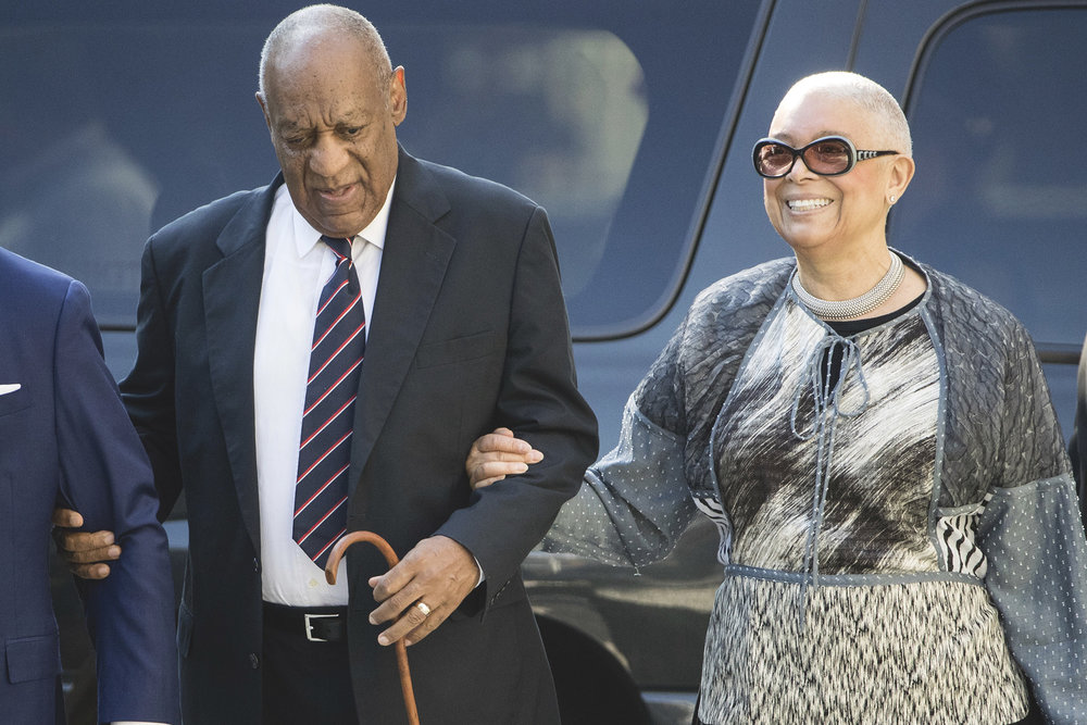 Photo courtesy of PA News Media Association. Camille Cosby enters Montgomery County Courthouse with Bill Cosby during his assault trial in April.