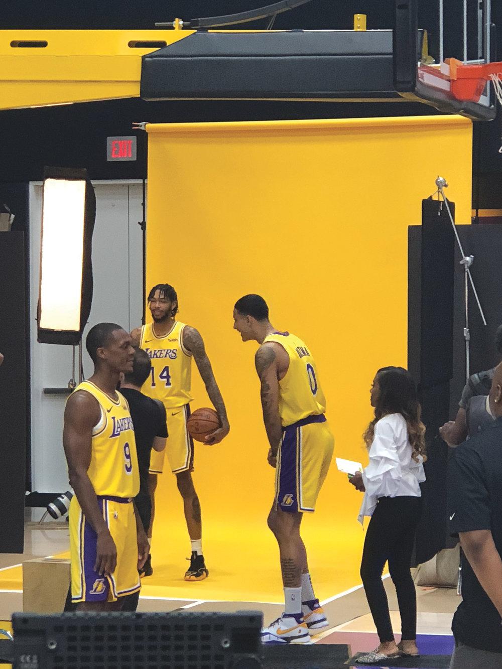 Brandon Ingram (14) and Rajon Rando (9) pose for pictures as Kyle Kuzma (0) watches on Lakers Media Day. (Los Angeles News Observer photo)