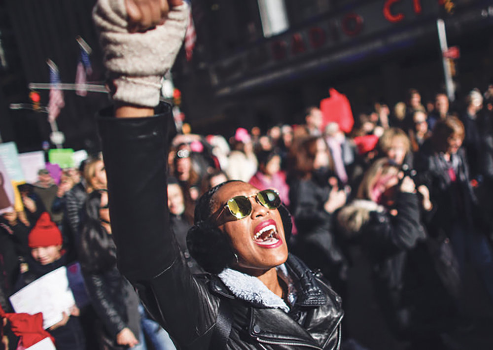 A woman shouts slogans during the Women's March in New York City, January 20, 2018, as protestors took to the streets en masse across the United States. It was a sign of lasting outrage, coming a year after the first women's marches following President Trump's inauguration. (KENA BETANCUR/AFP/Getty Images)