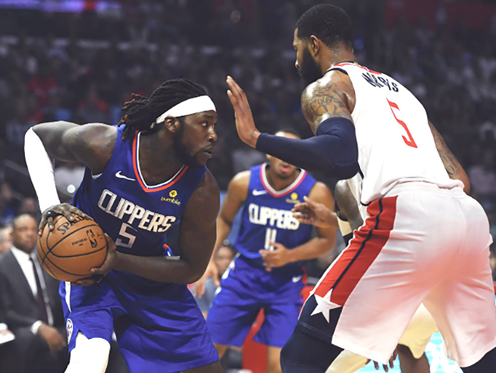 LOS ANGELES, CA – OCTOBER 28: Montrezl Harrell #5 of the Los Angeles Clippers drives into Markieff Morris #5 of the Washington Wizards in the first half at Staples Center on October 28, 2018 in Los Angeles, California. (Photo by John McCoy/Getty Images)