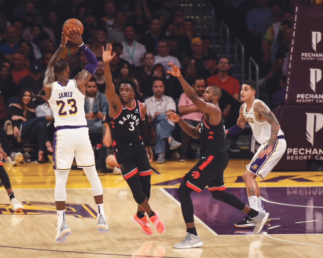 LeBron James shoots a jumper early in the game on Sunday vs. the visiting Toronto Raptors. (Jevone Moore / Full Image 360 photo)