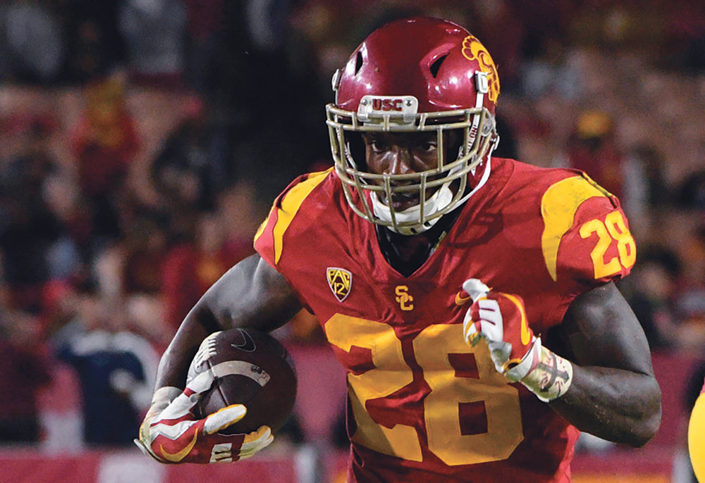 Through nearly two weeks of USC training camp, senior running back Aca'Cedric Ware has received most of the reps with the first-team offense. He hopes to fill the departed Ronald Jones' shoes by becoming more of a home run threat. (File Photo, Los Angeles Daily News/SCNG)