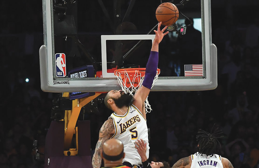 Lakers Center Tyson Chandler (Compton Dominguez) goes up above the rim for the game saving block in Staples Center Sunday night as the Lakers defeated the visiting Atlanta Hawks 107-106. (Sports Illustrated courtesy photo)