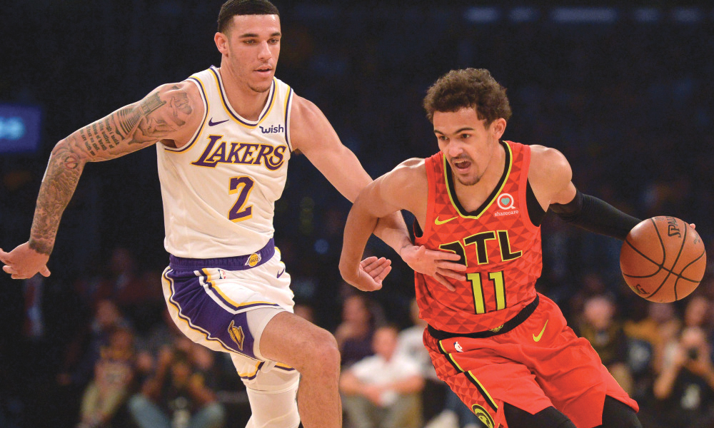 Lakers guard Lonzo Ball (5) guarding Atlanta Hawks rookie Trae Young (11) in the Lakers 107-106 victory Sunday night. (USA Today courtesy photo)