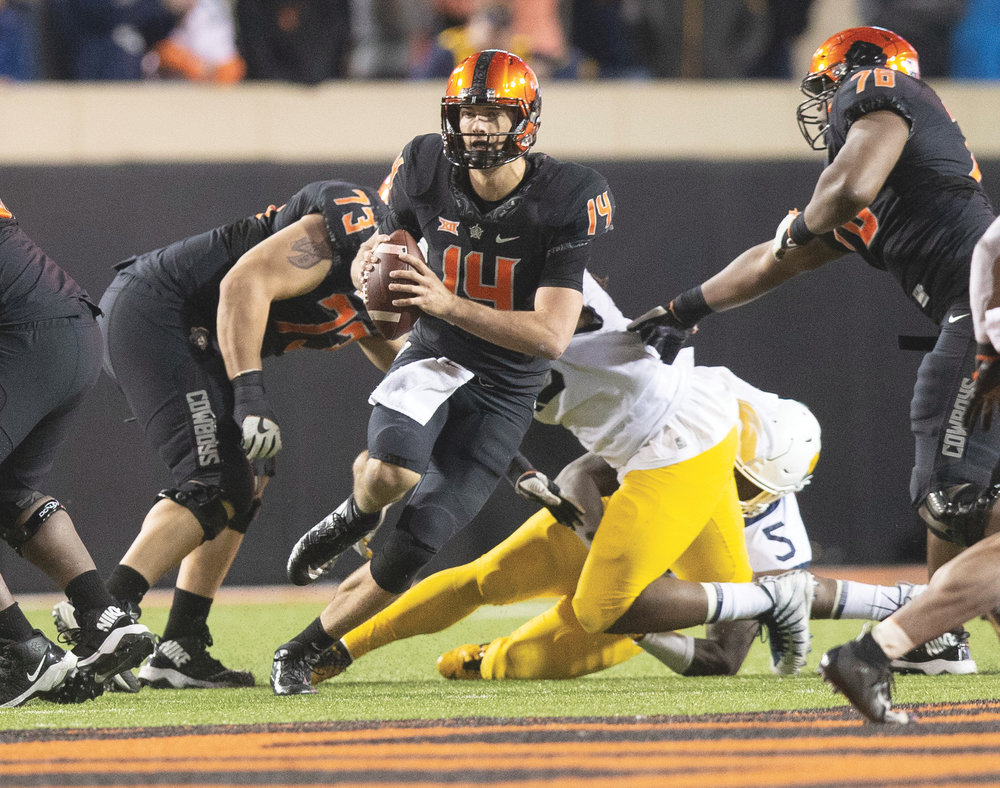 Taylor Cornelius (14) has big day earning Walter Camp Offensive Player of the Week (OSU Athletics courtesy photo)
